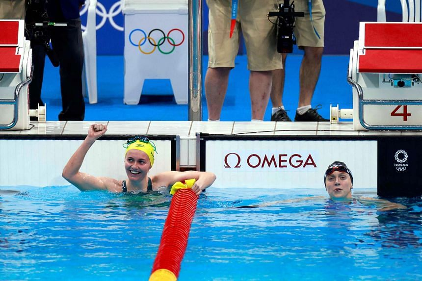 Ariarne Titmus (left) and Katie Ledecky in the women's 400m freestyle final at the Tokyo Aquatics Centre on July 26, 2021.