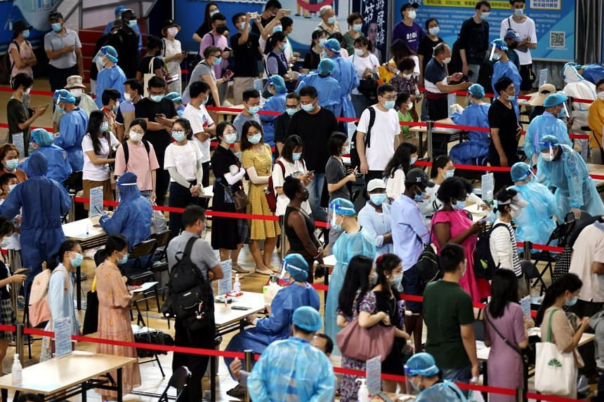 People line up during a citywide mass testing following new cases of the coronavirus in Nanjing, China on July 22, 2021.