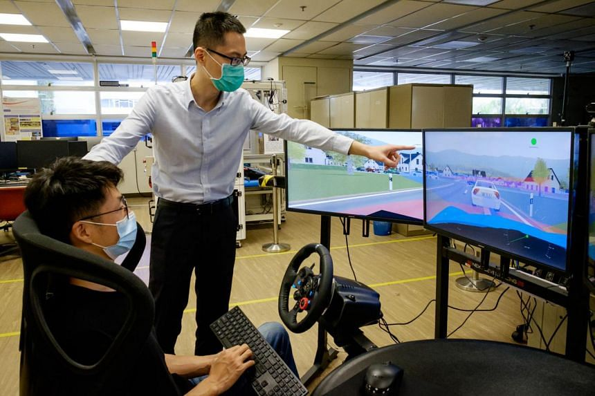 Assistant Professor Lyu Chen (right) and PhD student Mo Xiaoyu testing their traffic prediction tech in 3D simulation.
