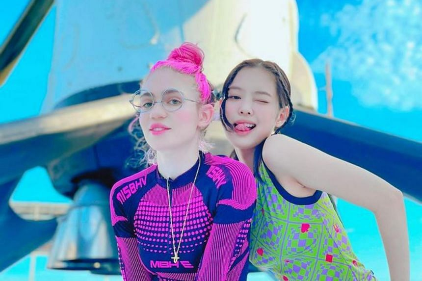 Blackpink's Jennie (right) and Canadian singer Grimes posed for photos with a rocket.