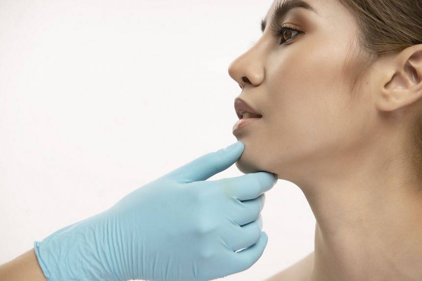 Medical aesthetic treatments are not only performed to reduce the signs of ageing, but also to create a well-balanced facial profile. (Picture posed by model.) PHOTO: GETTY IMAGES