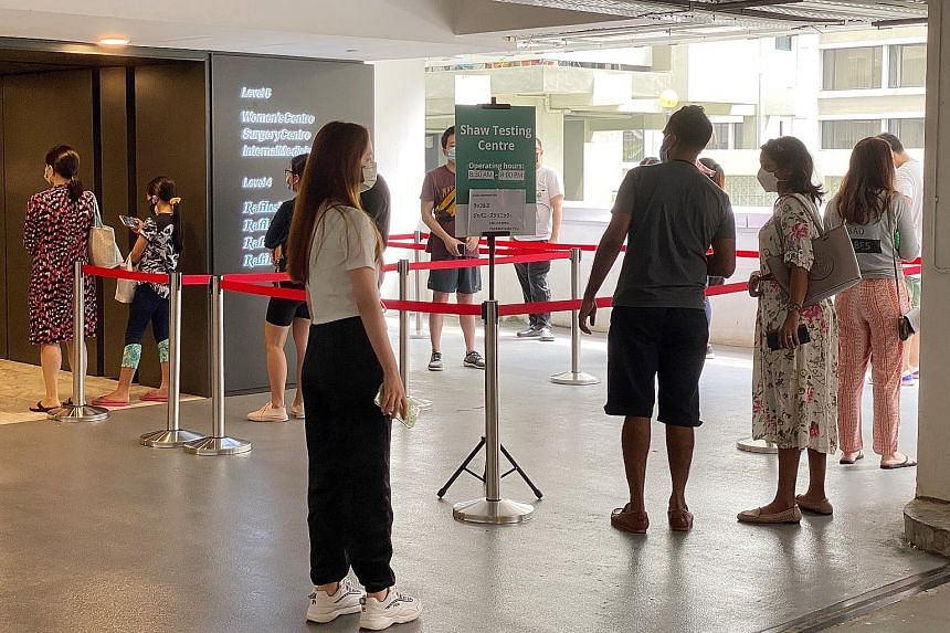 People waiting to enter the Raffles Medical test centre at Shaw Centre last month. The firm expanded its operations beyond air border screening and pre-event testing to include vaccination centres, pre-departure swabbing of cruise passengers, and PCR