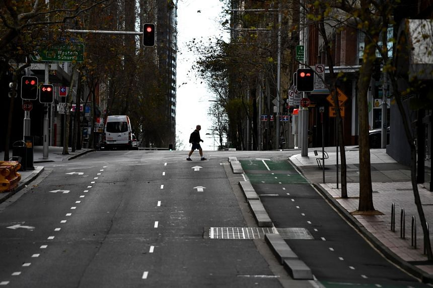 A pedestrian in the central business district of Sydney in Australia's New South Wales state on July 26, 2021.