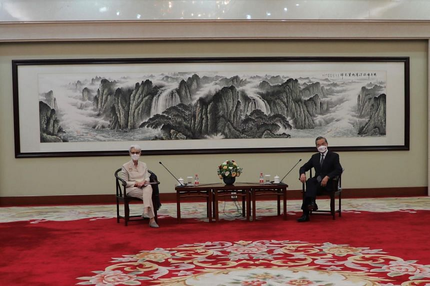 US Deputy Secretary of State Wendy Sherman (left) and Chinese Foreign Minister Wang Yi in Tianjin, China, on July 26, 2021.