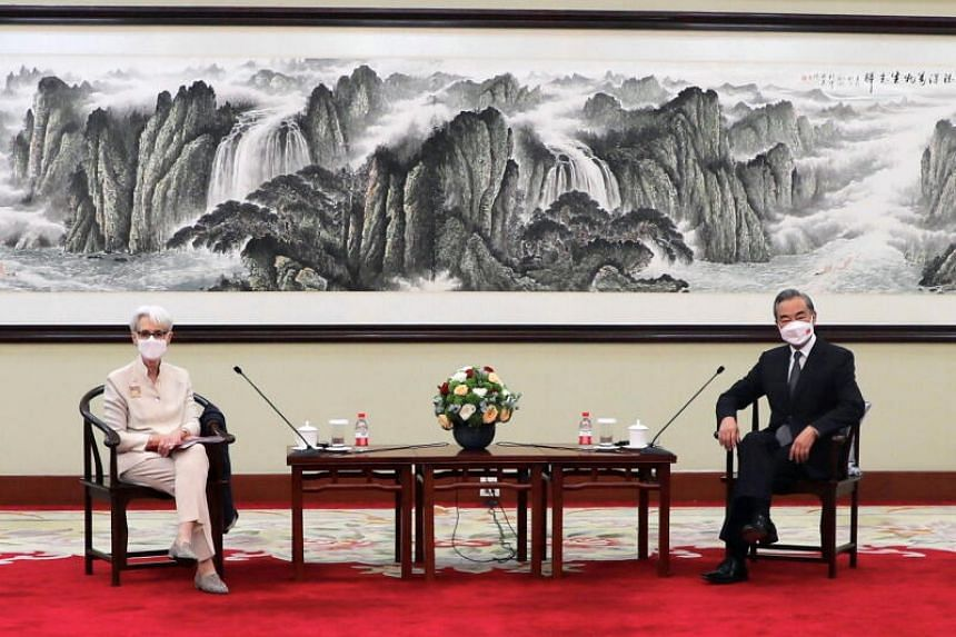 US Deputy Secretary of State Wendy Sherman (left) meets Chinese State Councilor and Foreign Minister Wang Yi, in Tianjin, China.
