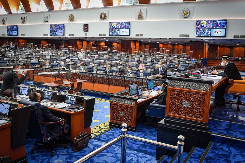 Members of Parliament attending a special five-day sitting a the Malaysian Houses of Parliament headquarters in Kuala Lumpur, Malaysia, 26 July 2021.