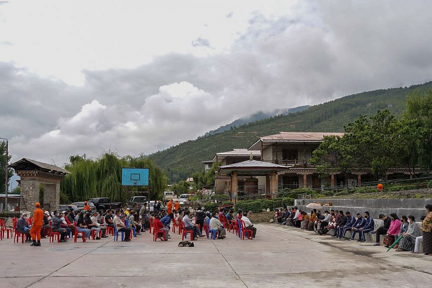 People queue up to receive the Covid-19 vaccine at a temporary vaccination centre in Thimpu, Bhutan, on July 20, 2021.