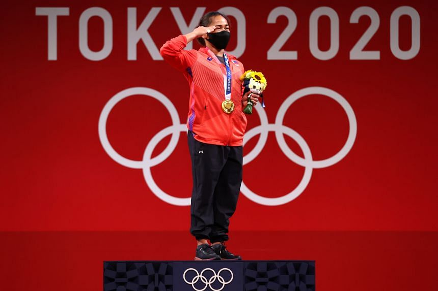 Gold medalist Hidilyn Diaz reacts after winning the Women's 55kg weightlifting event at the Tokyo International Forum in Tokyo, on July 26, 2021.