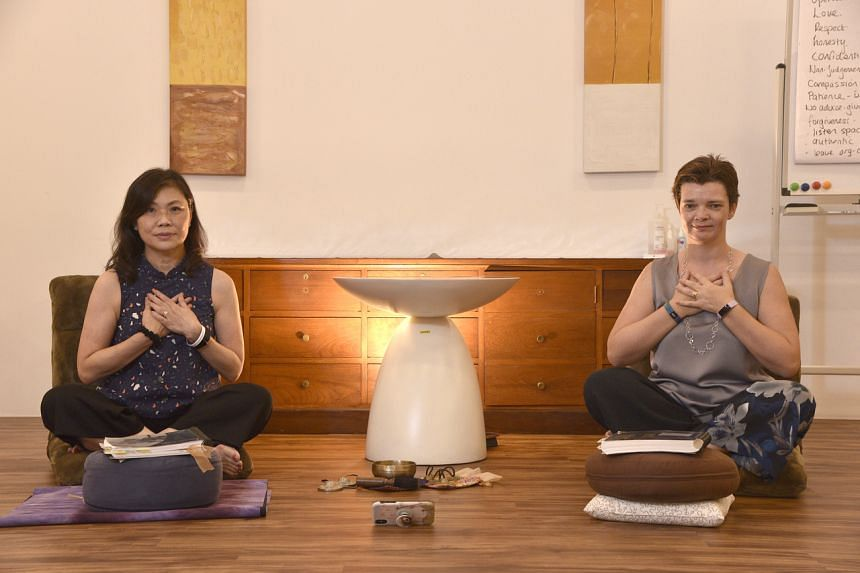Dr Mabel Yap (left) and Dr Tanya Tierney practising mindfulness at the Brahm Centre@Tampines.