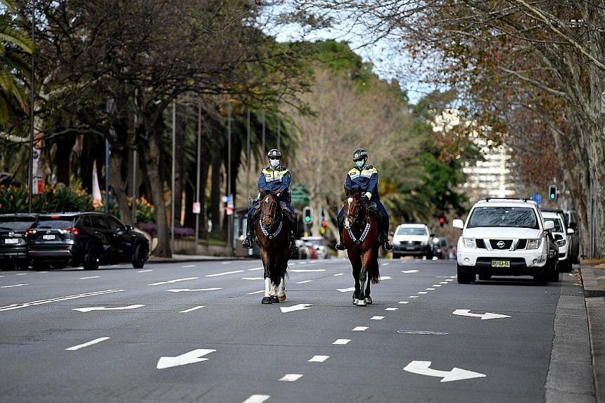 Mounted police on patrol in the central business district of Sydney, New South Wales, on July 25, 2021.