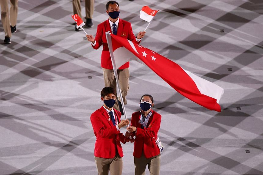Flag bearers Yu Mengyu and Kean Yew Loh lead their contingent during the athletes parade at the Tokyo 2020 Olympics opening ceremony on July 23, 2021.