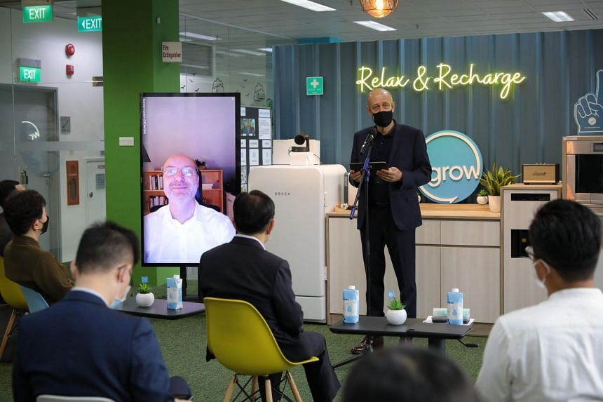 Bosch South-east Asia president Martin Hayes (in black) speaking at the firm's innovation hub launch on July 28, 2021.
