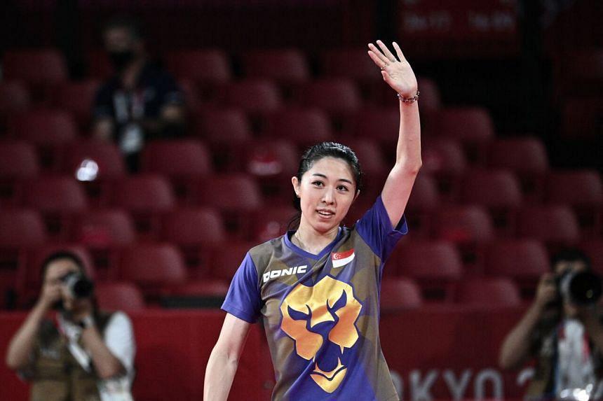 Yu Mengyu celebrates after defeating Japan's Kasumi Ishikawa at the Tokyo Metropolitan Gymnasium on July 28.
