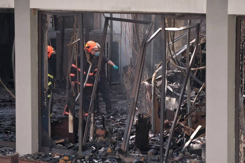 SCDF is performing damping down operations to prevent the fire from rekindling.