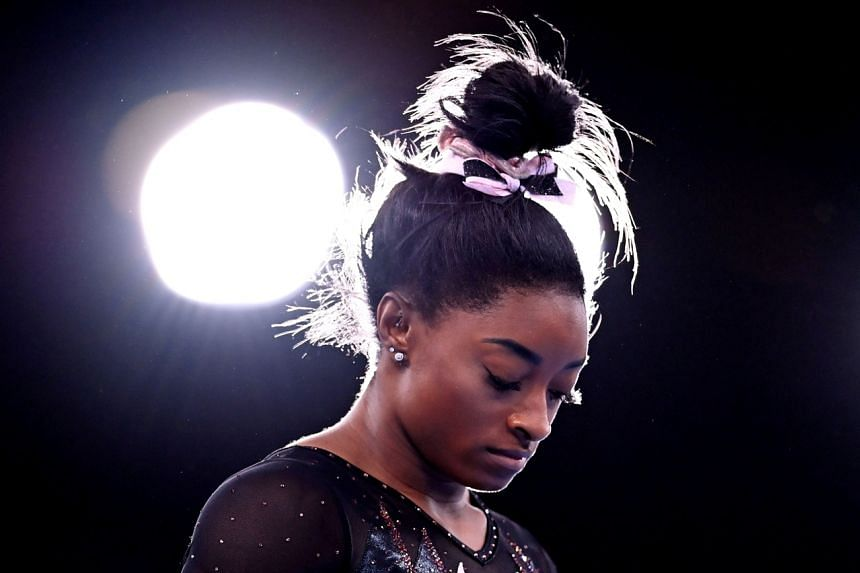 Simone Biles said she felt she had been carrying the weight of the world on her shoulders.