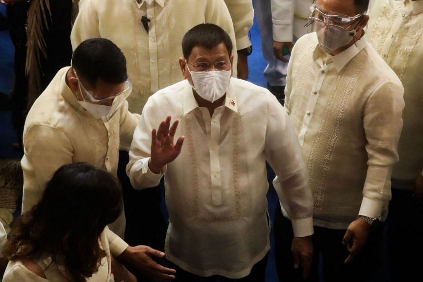 President Rodrigo Duterte waves after he delivered his the annual state of the nation address at the House of Representatives in Manila on July 26, 2021.