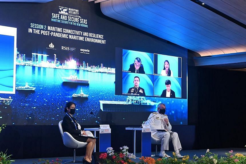 Colonel Lim Huay Wen (left), head of naval training at the Republic of Singapore Navy, and Rear Admiral Christopher Smith, Deputy Chief of the Royal Australian Navy, at a panel discussion at the 7th International Maritime Security Conference, held ye