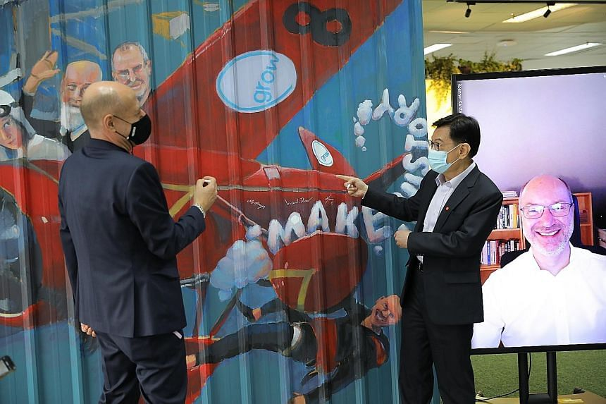 Deputy Prime Minister Heng Swee Keat with Mr Martin Hayes, president of Bosch in South-east Asia, at the launch of the German giant's South-east Asia innovation hub in Bishan yesterday. Also present at the event were National Research Foundation perm