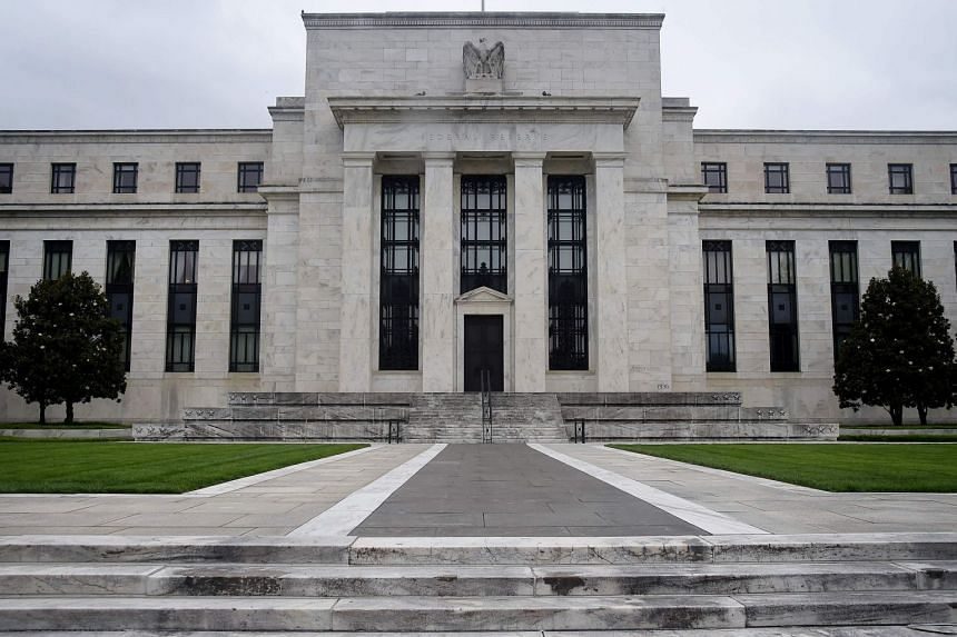 Economists expect the Fed (above) to begin slowing its debt purchases later this year or early in 2022.