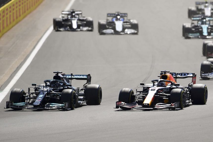 Hamilton (left) and Verstappen (right) are pictured after the start of the British grand prix on July 19, 2021.