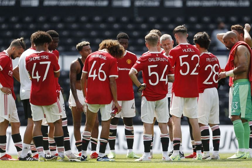Manchester United manager Ole Gunnar Solskjaer speaks with his players after a friendly against Derby County on July 18, 2021.
