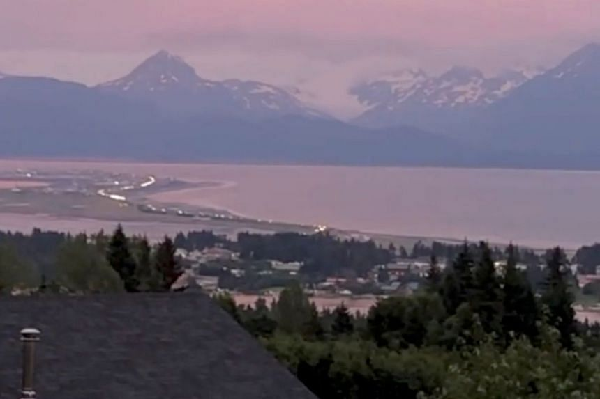 A still image from video shows vehicles evacuating Homer Spit following a tsunami warning after the quake, in Homer, Alaska.