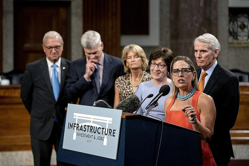 Senator Kyrsten Sinema, a Democrat from Arizona, speaking at a news conference in Washington on Wednesday. The vote was a victory for President Joe Biden, who has long promised to break through the partisan gridlock gripping Congress and accomplish b
