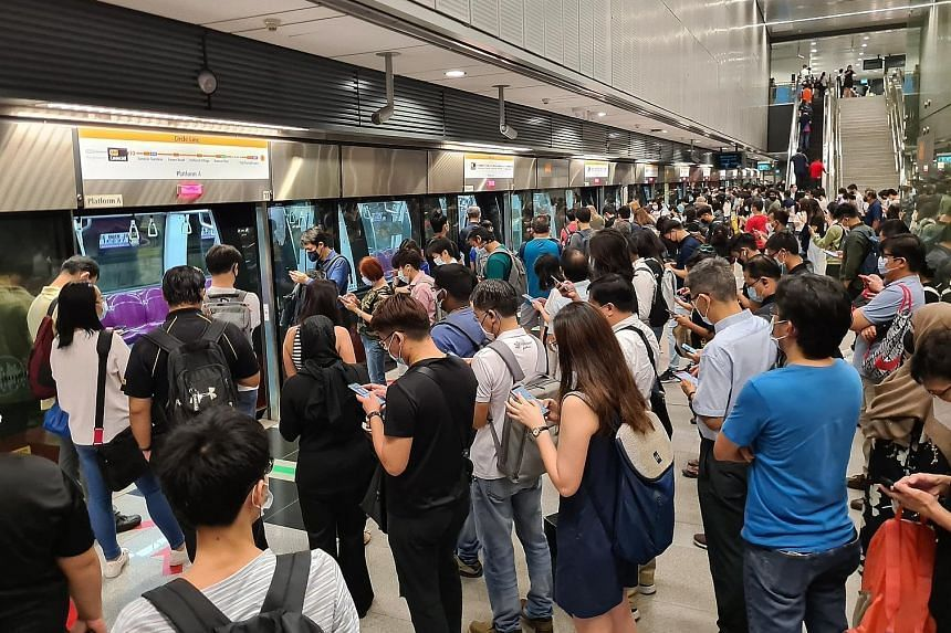 A large crowd of commuters waiting for the train at Caldecott station during morning peak hours on July 29, 2021.