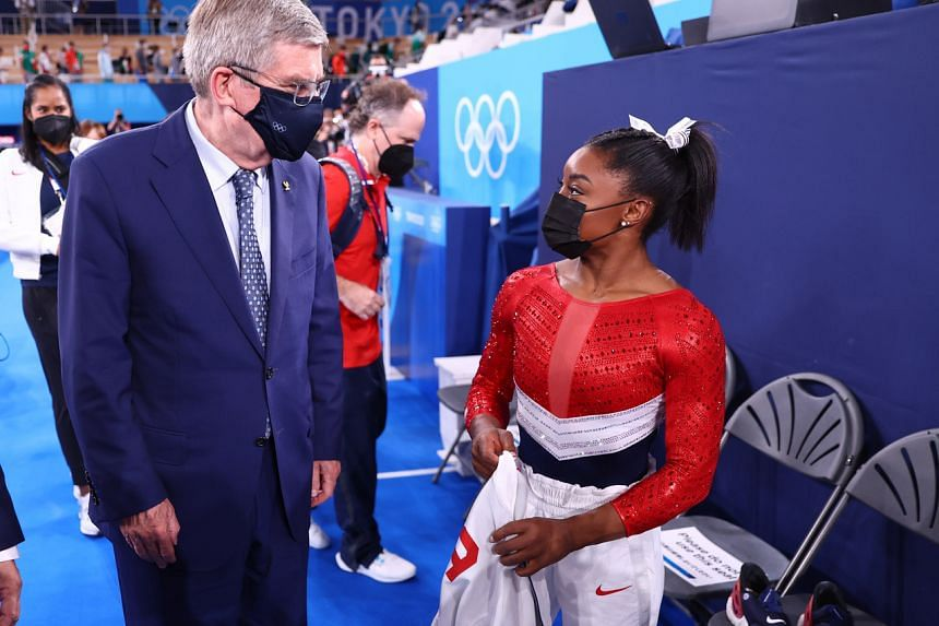 IOC president Thomas Bach with Simone Biles in Tokyo on July 27, 2021.