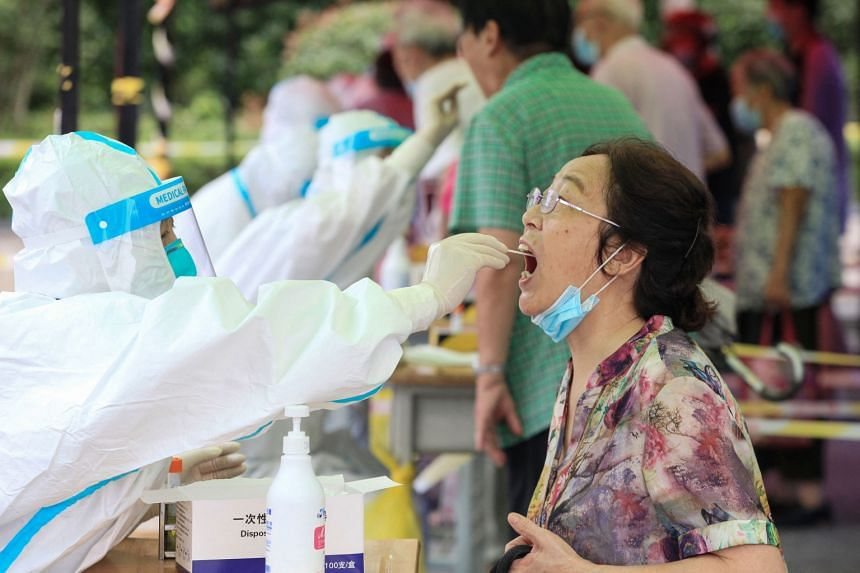 A woman receives a nucleic acid test for Covid-19 in Nanjing, in eastern Jiangsu province, on July 29, 2021.