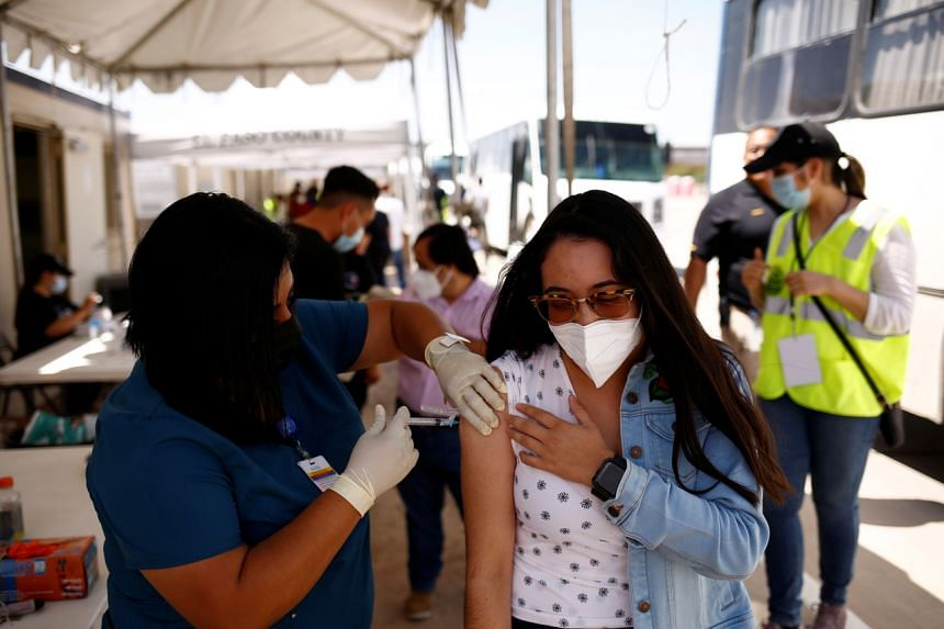 A woman receives a dose of the Johnson & Johnson Covid-19 vaccine in Tornillo, Texas on July 28, 2021.