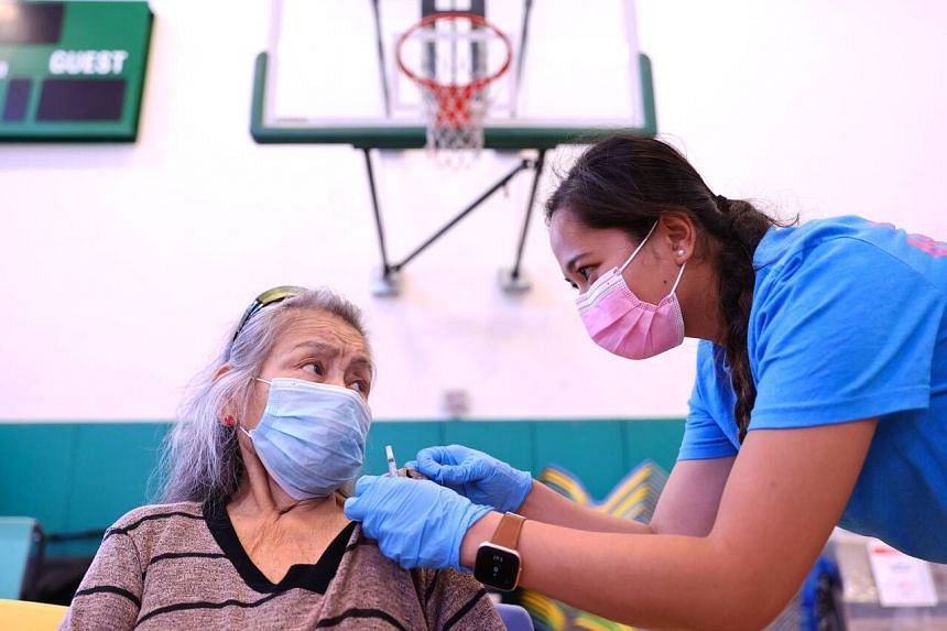 A nurse administers a dose of the Pfizer Covid-19 vaccine at a vaccination clinic on July 29 in Wilmington, California.