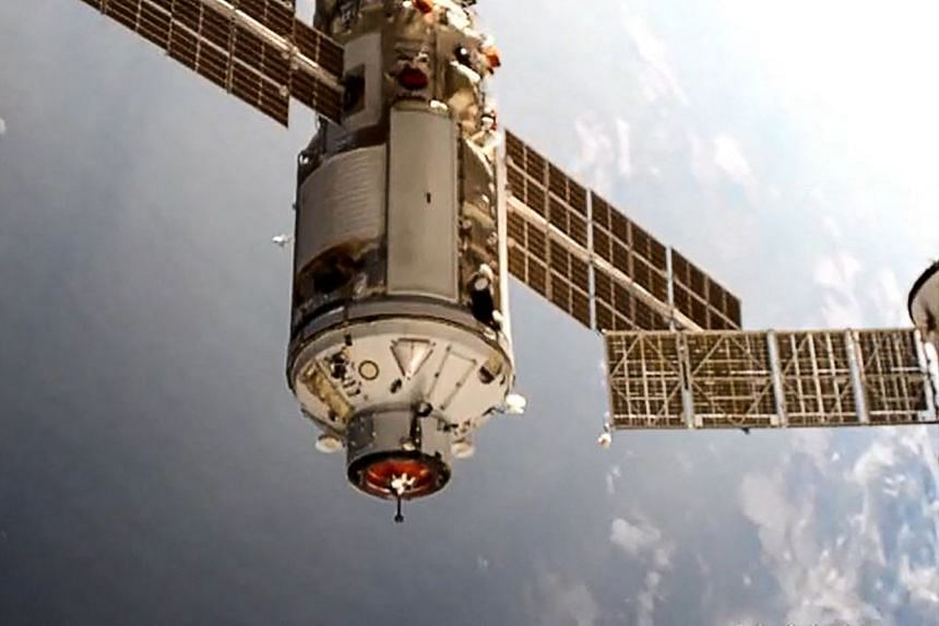 A Roscosmos photo shows the Nauka module docking with the International Space Station.