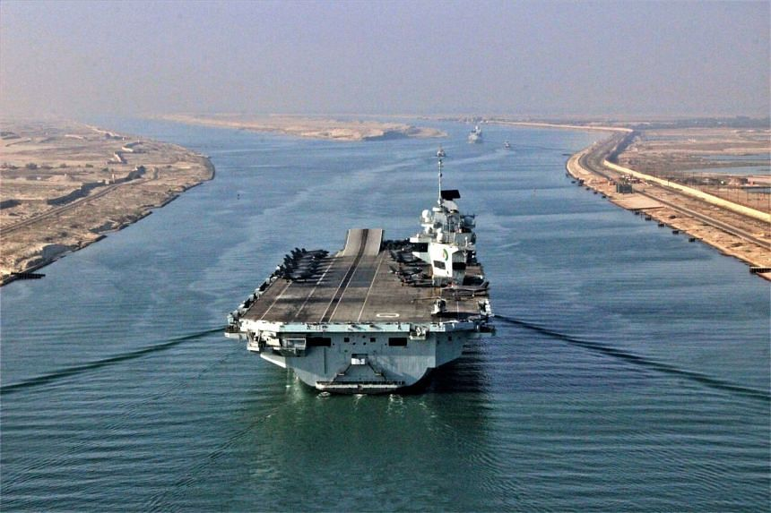 HMS Queen Elizabeth has been coordinating exercises with the navies of India and Malaysia in recent days.