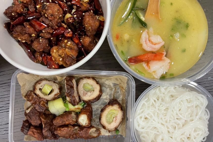 Clockwise from top left: Find The Chicken In The Chilis, Fried Crispy Pig's Intestines and King Prawns Noodle (soup with rice noodles packed separately).