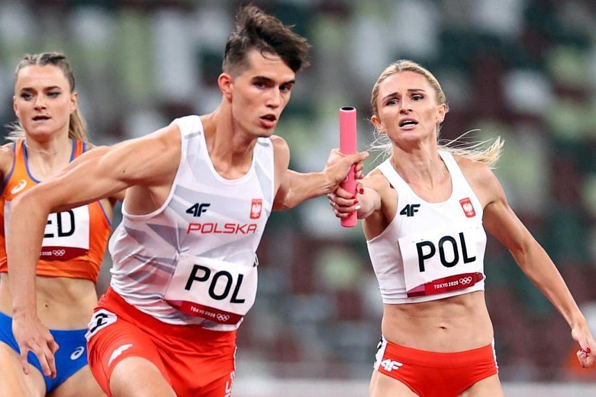 Malgorzata Holub-Kowalik handing over the baton to Poland teammate Kajetan Duszynski during the second heat.