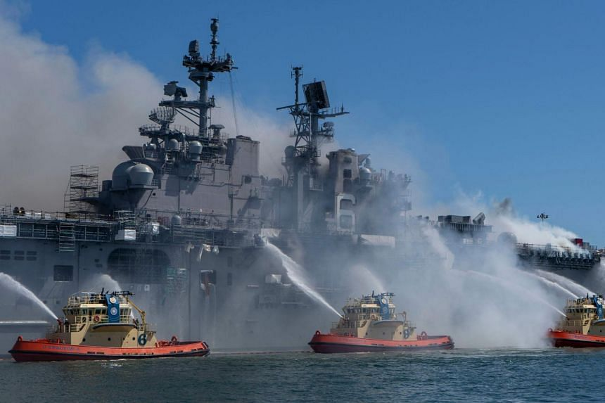 Firefighting vessels combating a blaze on board the USS Bonhomme Richard at Naval Base San Diego on July 12, 2020.