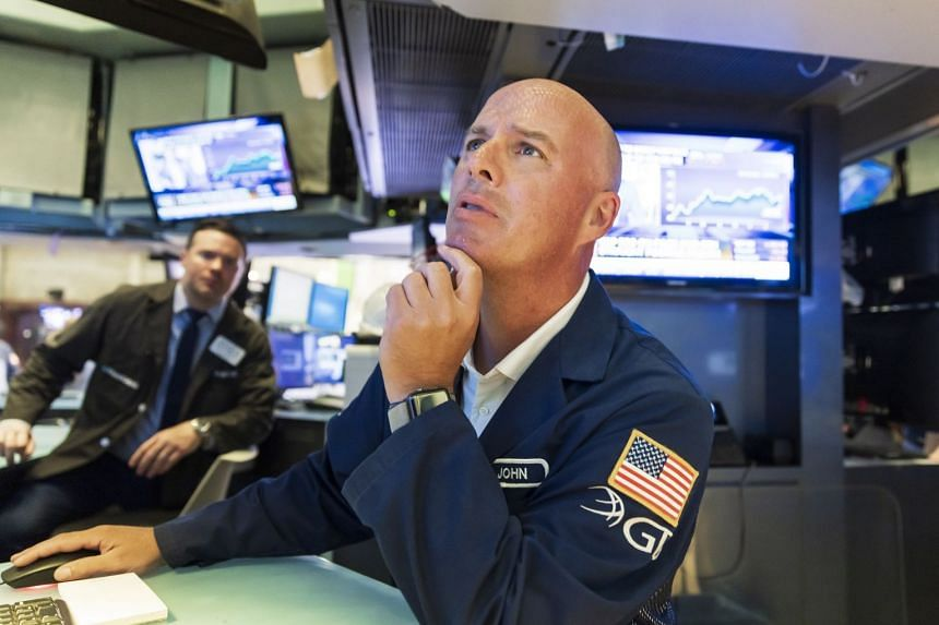 Traders work on the floor of the New York Stock Exchange on July 30, 2021.