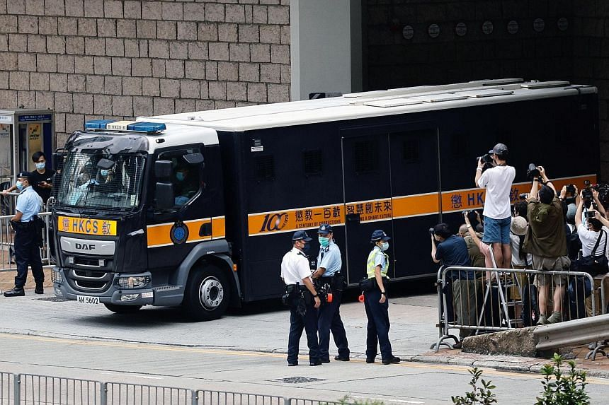 A prison van carrying Tong Ying-kit (above) leaving the High Court in Hong Kong yesterday after the 24-year-old's sentencing. He was accused of driving his motorcycle into three riot police officers during a protest last year while carrying a flag wi
