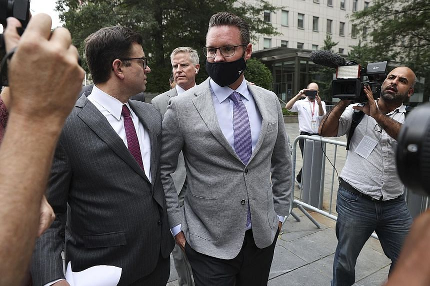 Trevor Milton (centre), founder of start-up automaker Nikola, leaving federal court in New York on Thursday. An indictment by the US attorney's office in Manhattan charged Milton with misleading investors - in particular individual investors - about