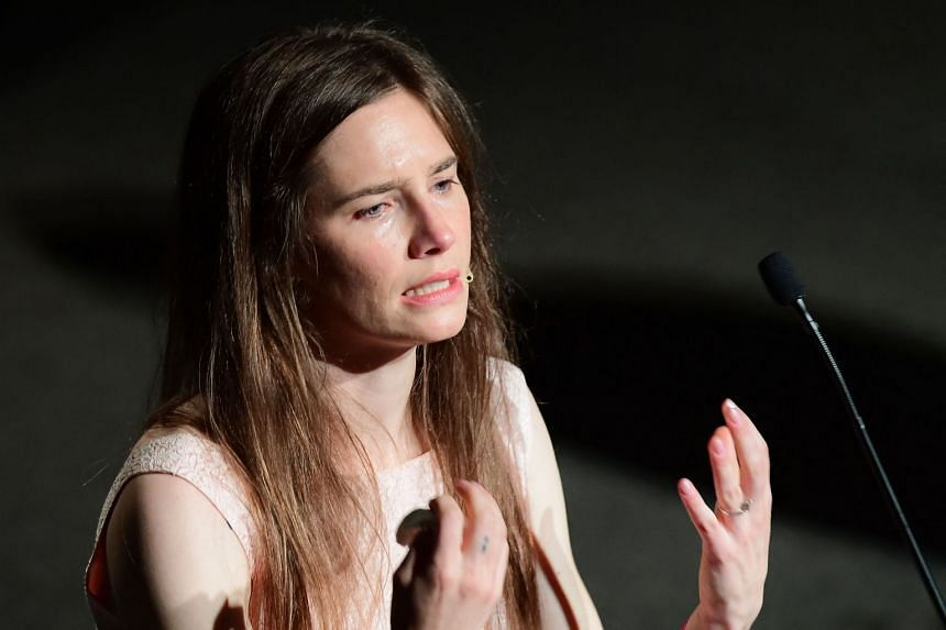 """A 2019 photo shows Amanda Knox addressing a panel discussion titled """"Trial by Media"""""""