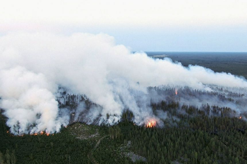 An aerial view shows a forest fire raging in Kalajoki, north-western Finland.