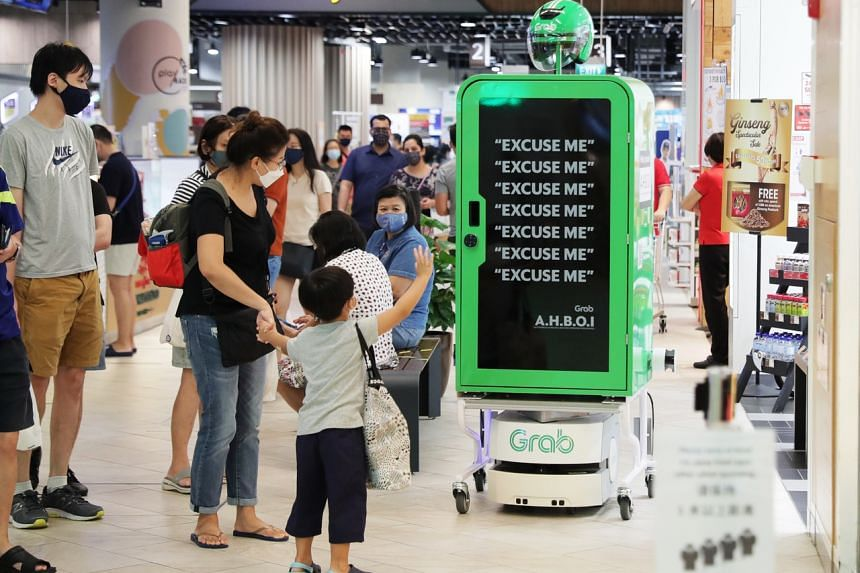 Grab Singapore's pilot robot runner. Experts say that in high-end manufacturing, Singapore leads in high-tech, industrial automation and biotech.