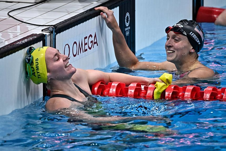 Ariarne Titmus (left) and Katie Ledecky after Titmus wins the 400m freestyle final at the Tokyo Aquatics Centre in Tokyo, on July 26, 2021.
