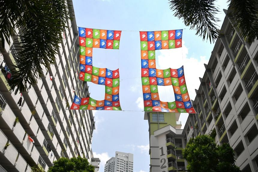 A group of seniors living in Toa Payoh stitched 92 flags together to form a display which flies high between blocks 123 and 125 Lor 1 Toa Payoh.