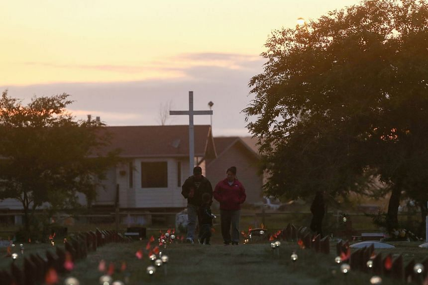 Recently installed solar lights mark burial sites, after a search found 751 unmarked graves at the site of Marieval Indian Residential School, near Grayson, Saskatchewan, in July 2021.