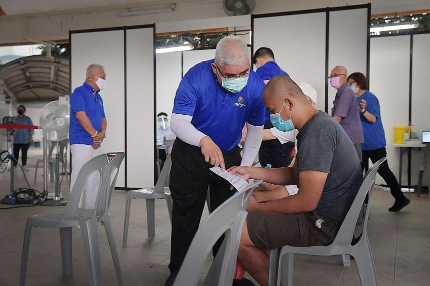 A mobile vaccination team at 22A Whampoa Precinct Hall yesterday. Since July 7, mobile vaccination teams alone have reached out to about 3,240 individuals, said the Ministry of Health in an update yesterday. ST PHOTO: ALPHONSUS CHERN