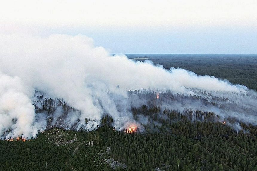 The forest fire raging in Kalajoki, north-western Finland, on Monday. An exceptionally long heatwave saw the country experiencing record temperatures this summer, with June averaging 20 deg C, some four to five degrees above historical averages. PHOT