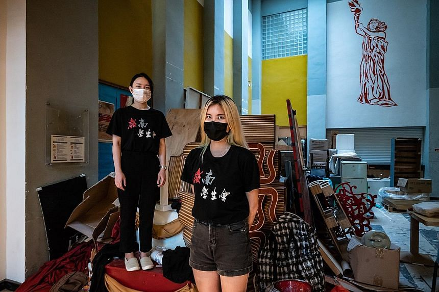 Ms Kitty Law (far left), a first-year member of the student union at Lingnan University, and Ms Yanny Chan, a leader of the union, do not want the group to disappear, but are wondering how much longer it will exist as the authorities clamp down on st