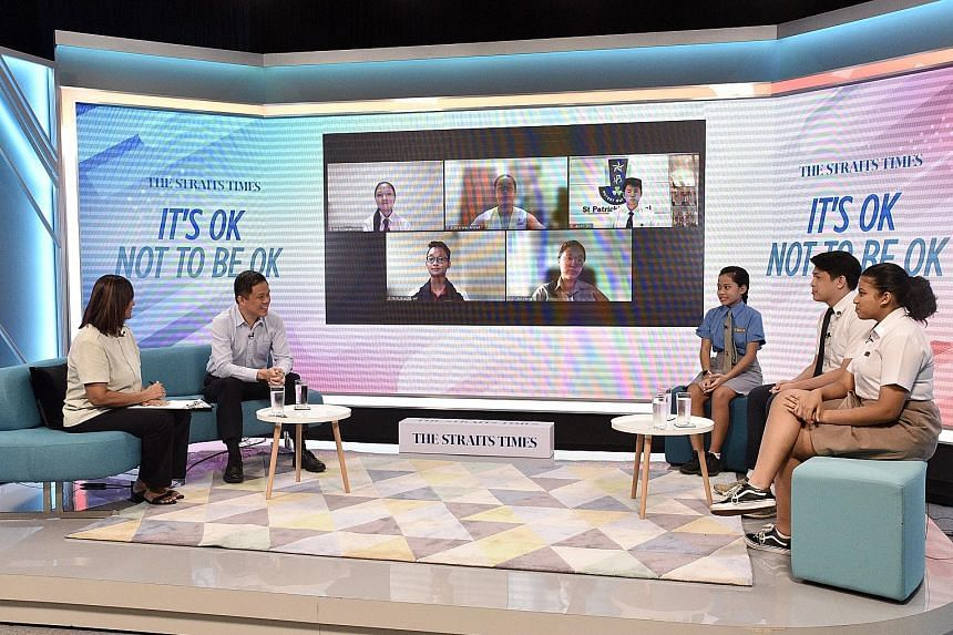 Education Minister Chan Chun Sing, with Straits Times senior education correspondent Sandra Davie as moderator, at Friday's mental well-being dialogue with junior college and secondary school students. During the session, the students also described